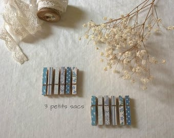 Clothespins miniature wooden dressed in blue and white cotton fabric