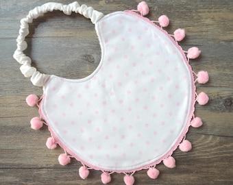 Pink polka dot bib with pompom