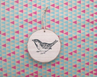Hanging decoration to hang wooden bird motif.