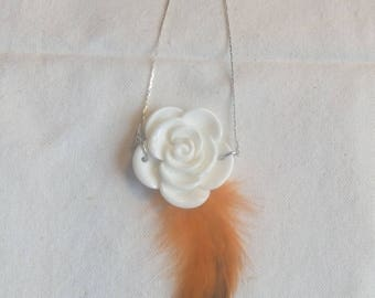 Resin rose pendant with natural orange feather