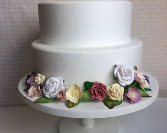 Soft cream, pinks, and purples floral cake wrap
