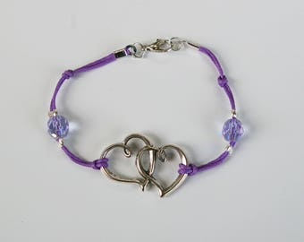 Silver heart bracelet, pearl purple on purple cord