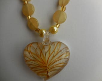 yellow and white murano heart