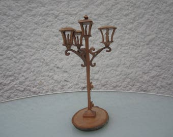 Floor lamp with four candles.