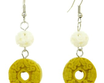 Women earrings dangling white pearls and yellow donut has reliefs