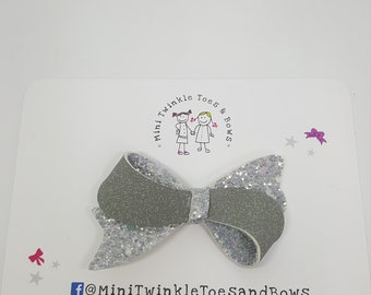 Grey suede and glitter bow