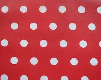 Tissu enduit rouge à pois blancs