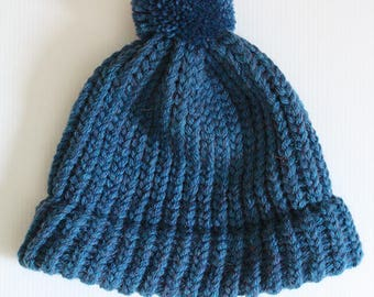 Hot blue wool hat with PomPoms