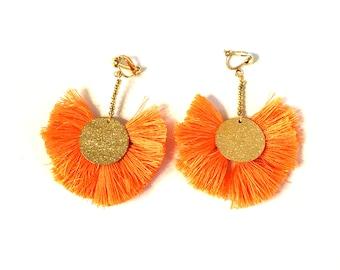 Orange tassel earrings, gold