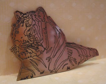 Tiger 524 stamped on a colored plexi or an embellishment for scrapbooking