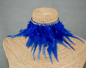 Electric Blue feather with blue and silver crust of diamonds.