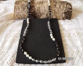 Beautiful long necklace plastic beads threaded on elastic.