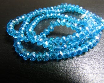 set of 30 iridescent light blue Crystal beads