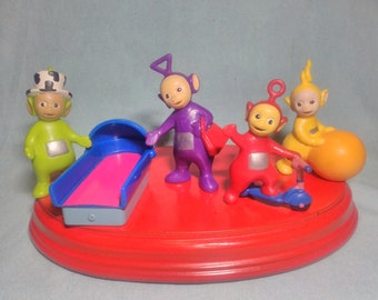 4 Teletubbies figures and Bullyland brand accessory in PVC rubber.