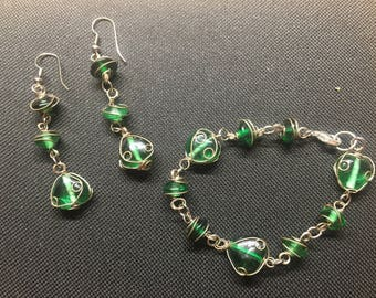 Beautiful wire wrapped green glass bracelet and earrings set