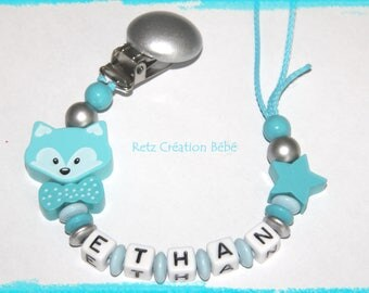 Pacifier wood Fox turquoise blue and silver