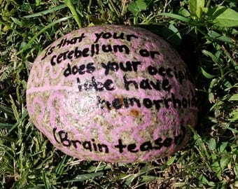 Painted brain rock with brain teaser written on it, Halloween decoration