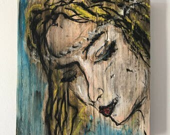 Angel's face painted on an old beech board / Twarz anioła malowana na starej bukowej desce