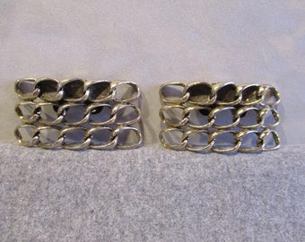 "Pair of ""Musi"" brass shoe buckles"