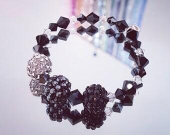 Bracelet while Swarovki Crystal with a 3 MeshBalls tranparent, hematite and jet (black)