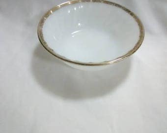 Vintage white milk glass fireking saucer. Round with gold trimming.