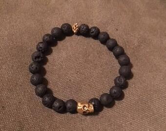 Gold Skull Lava Stone Bracelet