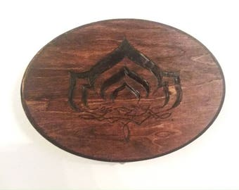 Warframe Lotus logo plaque.