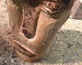 Chainsaw carving face