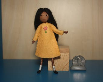 Little Felt Friend doll in pale yellow dress