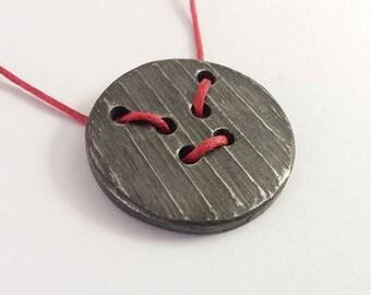 Button pendant - iron