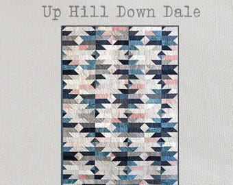 Up Hill Down Dale - Quilt Pattern - A stunning contemporary quilt design using traditional techniques and made with just two layer cakes!