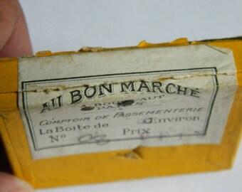 """Antique little box labeled """"Au bon marché"""" Comptoir de passementerie"""" with Small flowers bouquet of fabric for the buttonhole"""