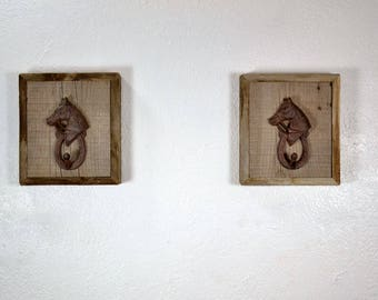 Cast iron horse head wall hooks mounted on reclaimed wood