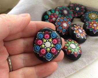 Mandala painted rock, lime green, bright pink, blue