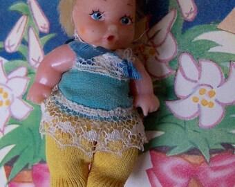 tiny vintage rubber doll