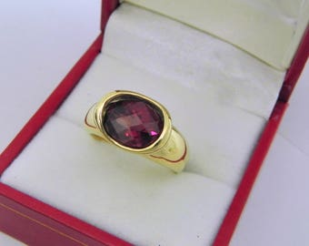AAAA Rhodolite Garnet  3.32 carats  10x8mm in 14K Yellow gold bezel set ring.  0256