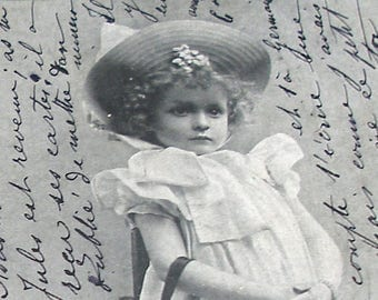 Antique French postcard, Girl in a hat. Real photo postcard (RPPC), paper ephemera.