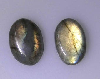 2 oval Labradorite cabochons, both have very good flash, 48.52 carats t.w.                 043-10-110