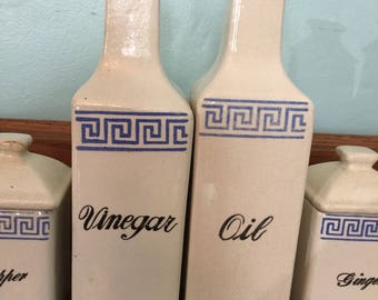 Oil and Vinegar Bottles with Matching Spice Jars