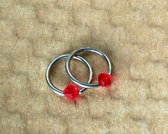 Captive Bead Ring, 16 Gauge, Surgical Steel, Autoclave Sterilized, Cartilage Jewelry, Ruby Red Crystals,