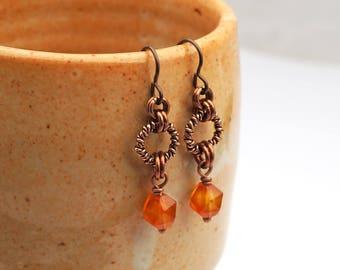 Copper carnelian earrings, Niobium French hooks, twisted ring dangle