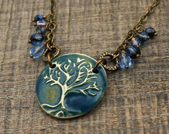 Blue tree necklace, antiqued brass chain, matte ceramic 21 inches long