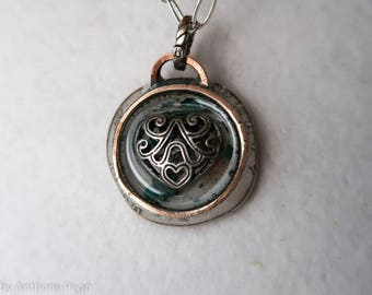 Filigree heart set in hand hammered year 1968 US quarter pendant featuring turquoise shards and Oklahoma red dirt