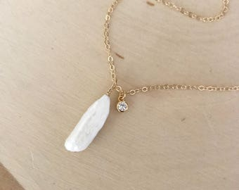 White Freshwater Pearl and Gold Pendant Necklace with Cubic Zirconia.