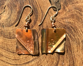 Repurposed Roofing Copper, fold formed and textured earrings.
