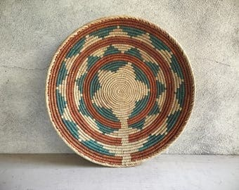 Vintage Native style coiled basket in teal and rust bohemian Southwestern decor