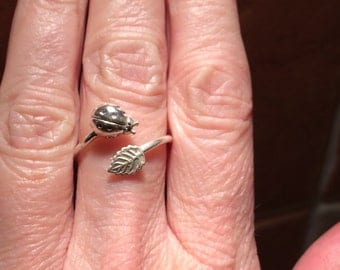 Sterling silver ladybird and leaf ring