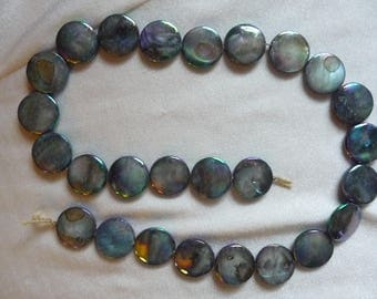 Beads, Mother of pearl 15mm blue/gray flat round coin.  Sold per 15 inch strand. There are 26 beads on the strand.