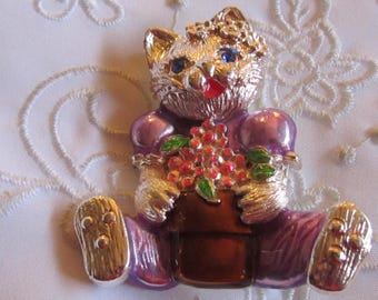 Vintage Cat Brooch with Blue Rhinestone Eyes and Purple Clothes Holding a Pot of Pink Flowers
