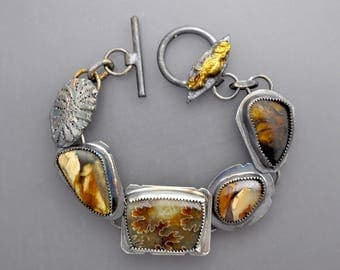 RESERVED for M.....Natural Wonders with Sutured Ammonite and Amber
